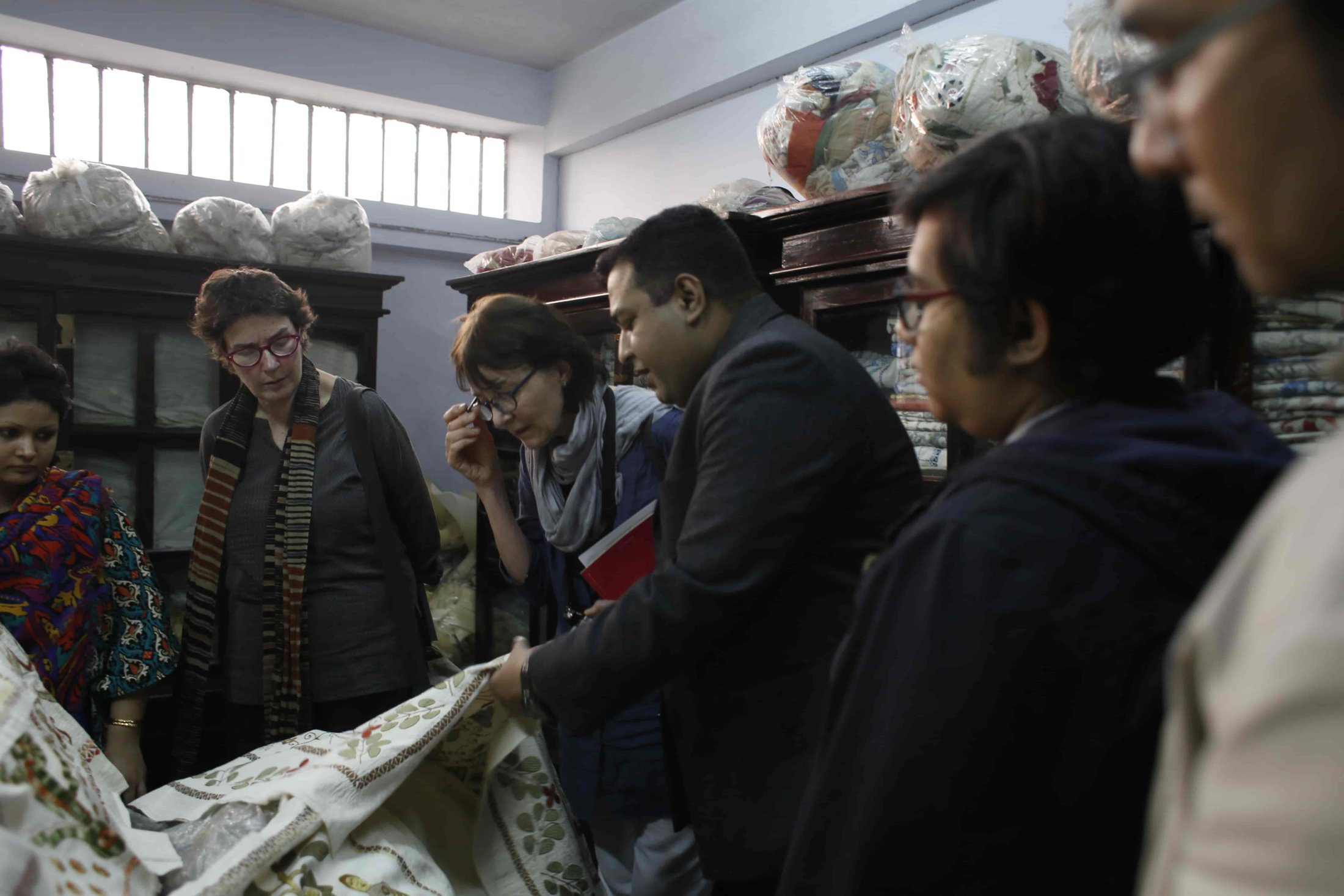 158. Looking At Textiles On Sale-min