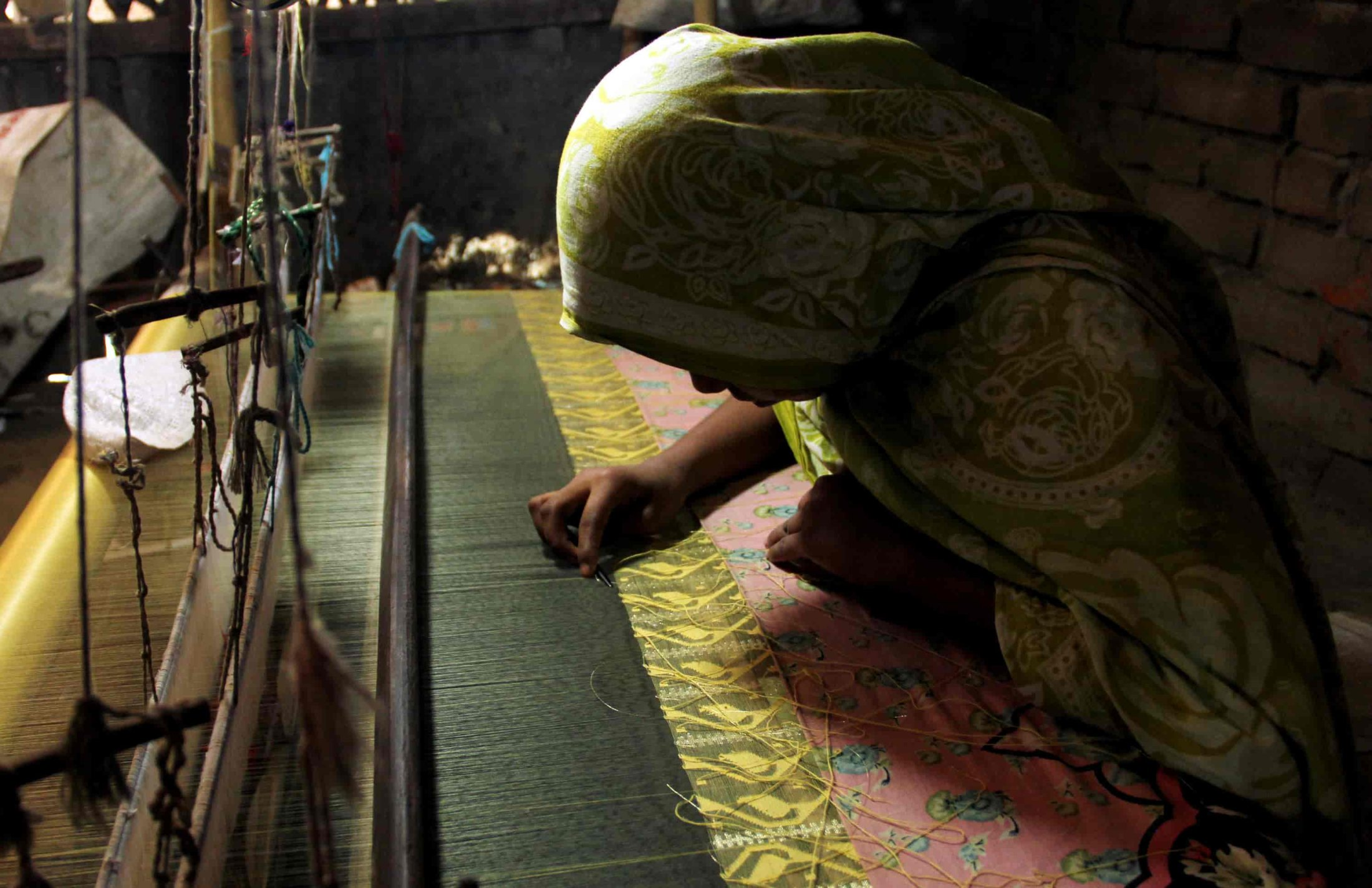 175. Busy At The Loom-min